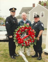 Left to right: Paul Bradley, a sergeant with the Pawtucket Police Dept., and a great-great-nephew of Officer Pierce, great-nephew Frank Seaman of Hyannis, and great-great-nephew Walter Benjamin, a lieutenant with MA Dept. of Correction.